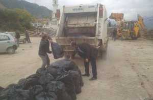 BOUZEGUÈNE (TIZI OUZOU) - Rachid Oudali, P/APC et éboueur volontaire