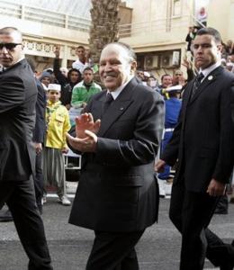 Algeria's President Abdelaziz Bouteflika, surrounded by body guards, applauds