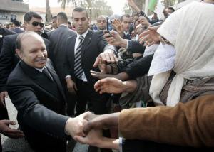 Algeria's President Abdelaziz Bouteflika shakes hands with supporters during