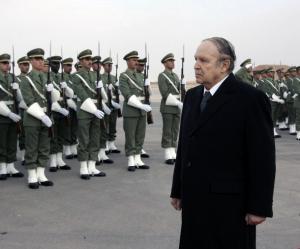Algeria's President Abdelaziz Bouteflika reviews a guard of honour