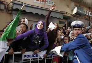 Supporters of Algeria's President Abdelaziz Bouteflika gesture during his