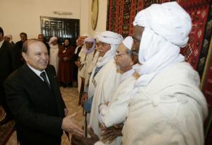 Algeria's President Abdelaziz Bouteflika (L) shakes hands with dignitaries