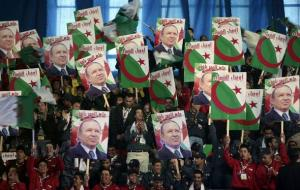 Supporters of Algeria's President Abdelaziz Bouteflika attend his official