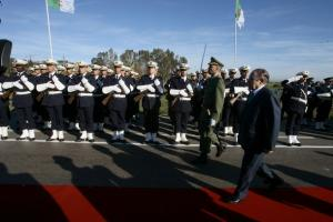 Algeria's President Abdelaziz Bouteflika walks past honour guards upon