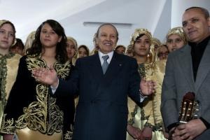 Algeria's President Abdelaziz Bouteflika poses with musicians at a