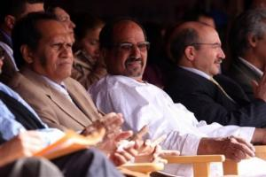 Saharawi President-in-exile Mohammed Abdelaziz, center, sits between regional governor