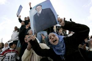 Supporters of Algeria's President Abdelaziz Bouteflika cheer during a presidential