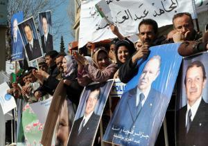 Algerians in support of President Abdelaziz Bouteflika celebrate during an