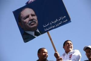 A supporter holding a poster of Algeria's President Abdelaziz Bouteflika