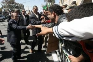 Algeria's President Abdelaziz Bouteflika (L) shakes hands with supporters as