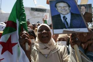 A supporter, holding a poster of Algeria's President Abdelaziz Bouteflika