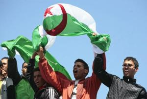 Supporters wave the Algerian flag as Algeria's President Abdelaziz Bouteflika