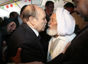 Algeria's President Abdelaziz Bouteflika (L) greets a local leader as