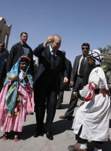 Algeria's President Abdelaziz Bouteflika (C) dances with children wearing traditional
