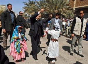Algerian President Abdelaziz Bouteflika, center, dances near young children wearing