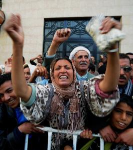An Algerian woman shouts slogans in support of President Abdelaziz