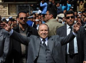 Algerian President Abdelaziz Bouteflika waves to his supporters during an