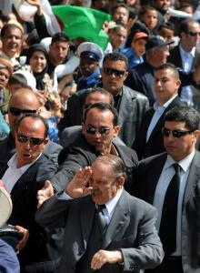 Algerian President Abdelaziz Bouteflika greets his supporters during an election