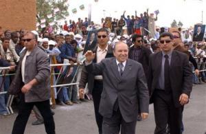 Algeria's President Abdelaziz Bouteflika, center, salutes crowds as he campaigns