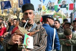 A musician plays his traditional Kabyle bagpipe as Algerian President