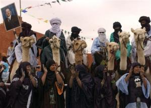 Algerians on camels and women in traditional dress welcome Algeria's
