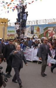 Algerians welcome Algeria's President Abdelaziz Bouteflika who is campaigning