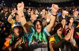 Supporters of Algerian President Abdelaziz Bouteflika shout slogans during an