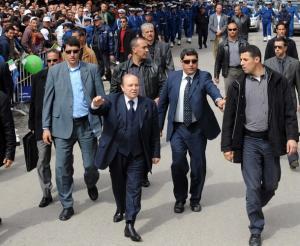 Algerian President Abdelaziz Bouteflika (front C) waves to supporters during