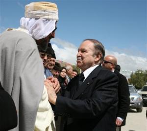 Algerian President Abdelaziz Bouteflika (right) embraces a religious leader in