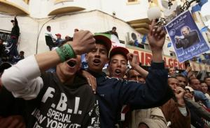 Supporters of Algeria's President Abdelaziz Bouteflika chant slogans during his