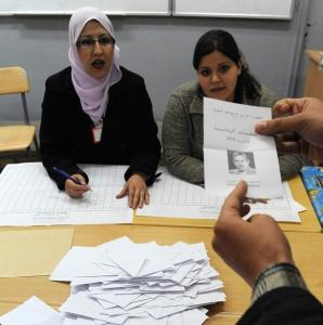 Algerians count ballots in a vote office in Algiers after