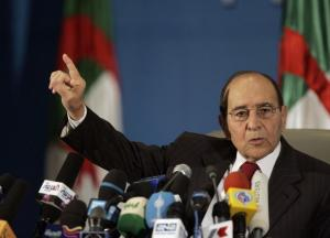 Algeria's Interior Minister Noureddine Yazid Zerhouni speaks to the media