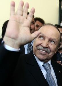 Algeria's President Abdelaziz Bouteflika waves to journalists at his campaign's