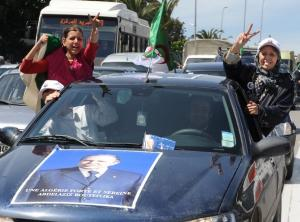 Algerians women flash the V for victory to celebrate along