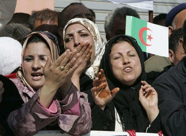 Supporters of Algeria's President Abdelaziz Bouteflika cheer during an election