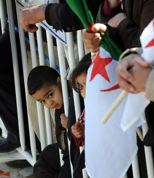 Algerian children look on as they attend President Abdelaziz Bouteflika's