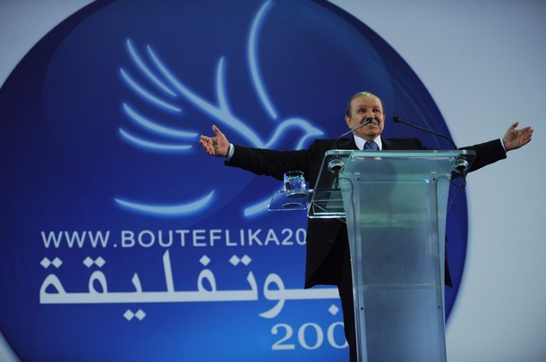 Algerian President Abdelaziz Bouteflika gestures to his supporters during an