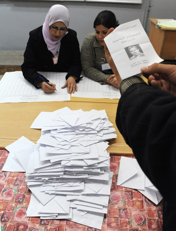 Algerians count the ballots in a vote office in Algiers