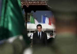 France's President Nicolas Sarkozy listens to the national anthem