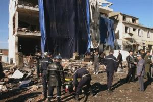 Rescuers and policemen work in front of the seriously