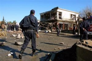 Policemen patrol near a seriously damaged building in Naciria,