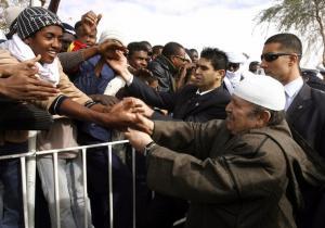 Algeria's President Abdelaziz Bouteflika shakes hands with residents during