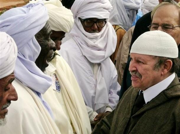 Algerian President Abdelaziz Bouteflika, right, meets Touareg men in