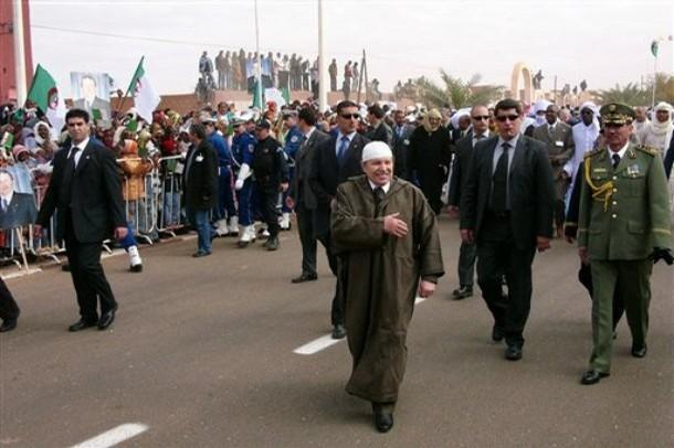 Algerian President Abdelaziz Bouteflika, foreground, closely escorted by bodyguards,