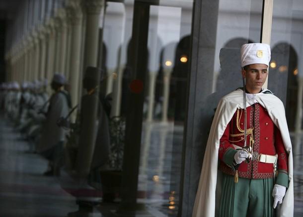 Algerian republican guards stand guard while Algeria's President Abdelaziz