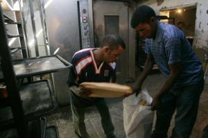 Two Sahrawi men work in a bakery at Dakhla's