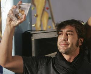 Spanish actor Javier Bardem holds his honorific prize during