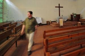 An Algerian Bishop of Protestants' church Moustapha Krim walks