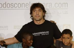 Oscar-winning Spanish actor Javier Bardem poses with Sahrawi children