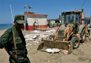 A mechanical shovel removes the debris, Sunday, Aug. 10,